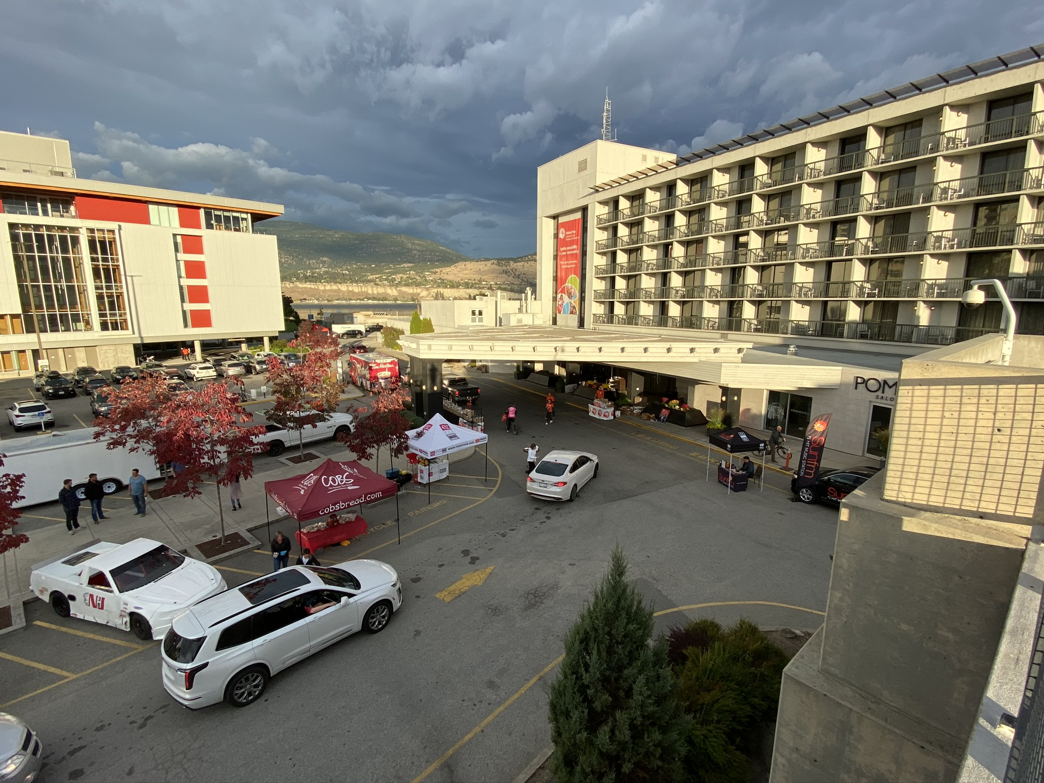 An aerial image of the South Okanagan Drive Thru, showing several cars in line.
